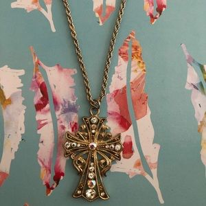 A gold cross necklace